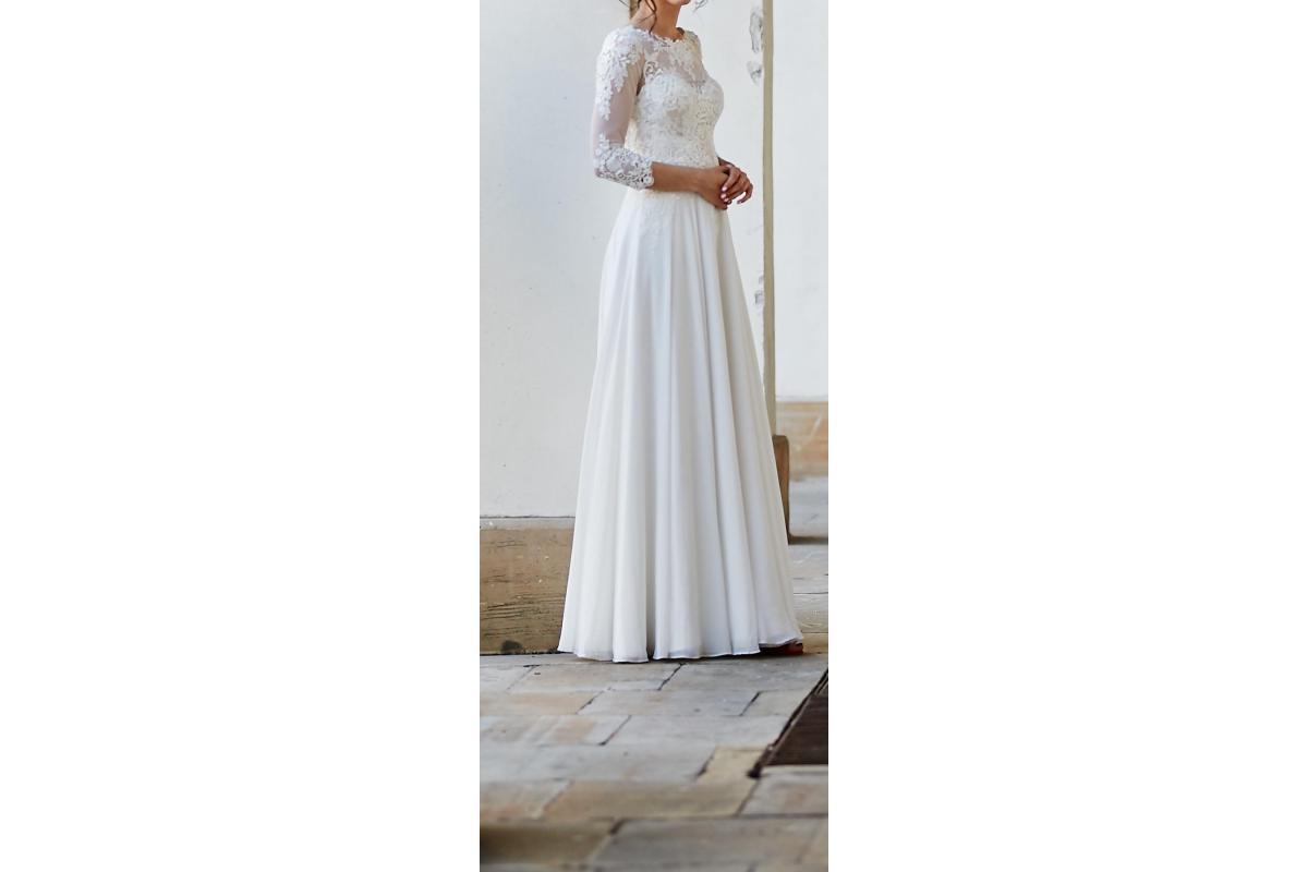 Zwiewna koronkowa suknia ślubna r 36