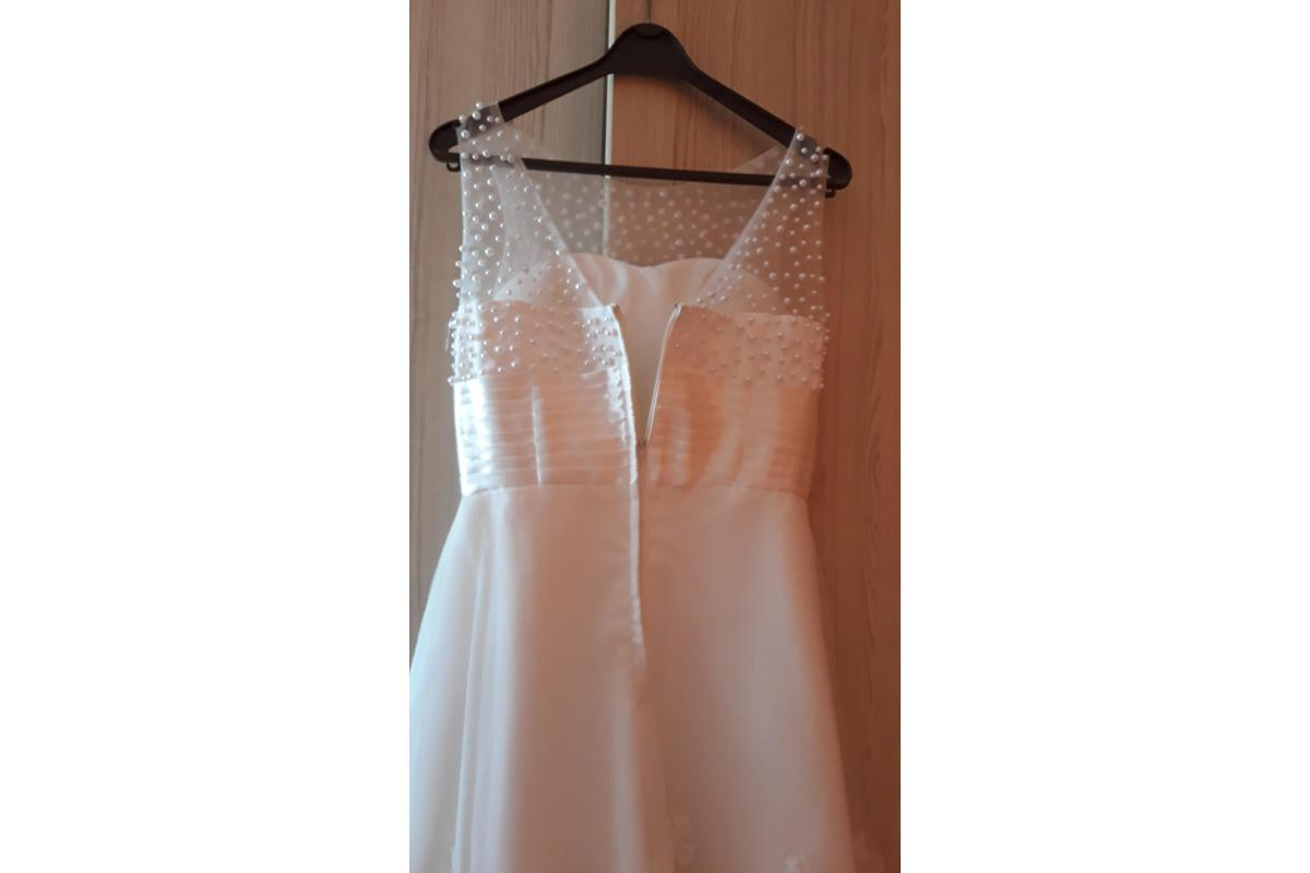 Śliczna,krótka koronkowa sukienka