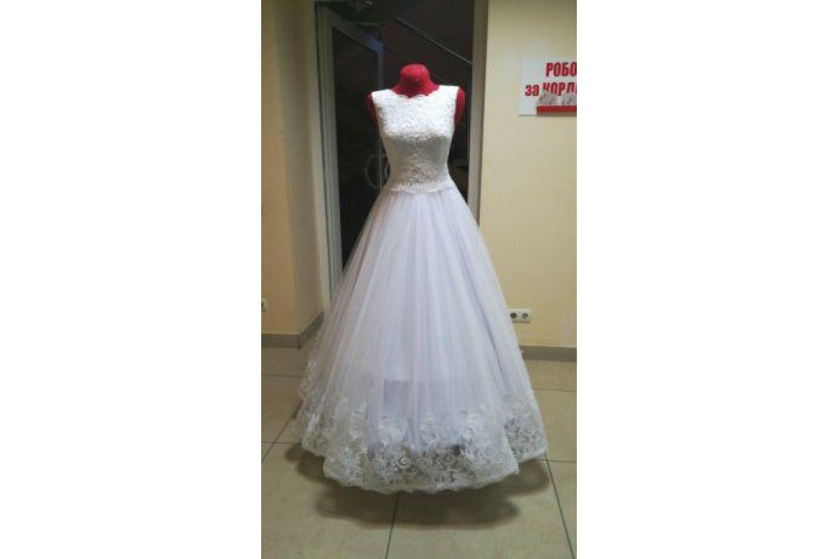 Urocza, nigdy nie założona suknia ślubna