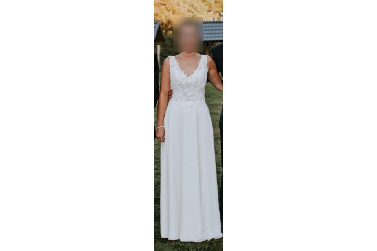 Elegancka, ręcznie haftowana suknia ślubna